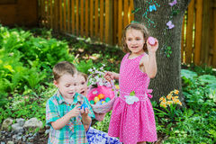 Two Little Girls and a Boy with Their Easter Eggs Stock Image