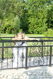 Two little girls on the bridge Royalty Free Stock Image