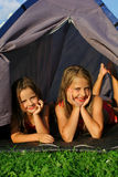 Two little girls camping stock photo