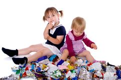 Two little girls in candy wrappers Royalty Free Stock Photography