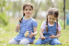 Two little girls with chickens Stock Photo