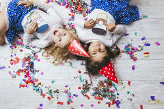 Free Two Little Girls Child Fashion Colorful Confetti On The Floor An Royalty Free Stock Photo - 98621195