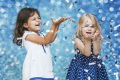 Free Two Little Girls Child Fashion With Silver Confetti In The Background With Patches Of Cute And Beautiful Stock Photography - 98621342