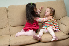 Two little girls conflicting royalty free stock photos