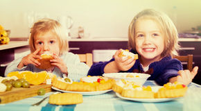 Two little girls with cream desserts stock photo