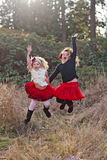 Two little girls dancing outdoors Royalty Free Stock Photos