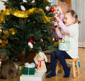 Two little girls decorating Christmas tree Stock Photography