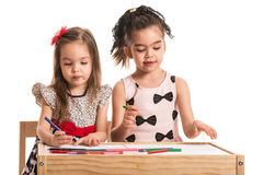 Two little girls drawing Stock Photos