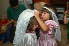 Two little girls dressing up in wedding outfits Stock Photography