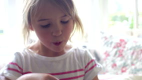 Two Little Girls Eating Cupcakes Together stock video