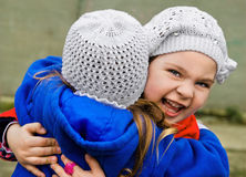 Two little girls embracing each other Royalty Free Stock Image