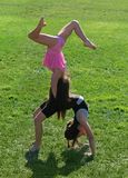 Two little girls exercising. In the park Royalty Free Stock Photography