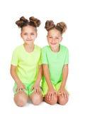 Two little girls in fancy garb. Two little girls in similar fancy garb stock photo