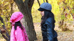 Two little girls fighting angry. Two girls fighting angry in autumn forest stock video footage