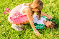 Two little girls fighting. Two little girls are fighting on the ground royalty free stock photography