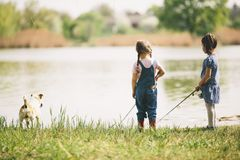 Two little girls at fishing Royalty Free Stock Image