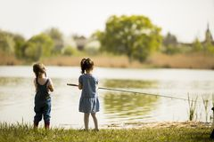 Two little girls fishing Royalty Free Stock Photo