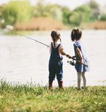 Two little girls fishing Stock Photos