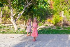 Two little girls on footpath in a tropical country royalty free stock photos