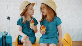Little girls give themselves kisses and wait for summer. Two little girls give themselves kisses and wait for summer holidays stock video footage