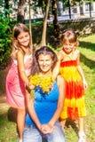 Two little girls giving mum flowers. Two little girls are giving mum flowers royalty free stock photography