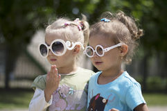 Two little girls with glasses Royalty Free Stock Photos