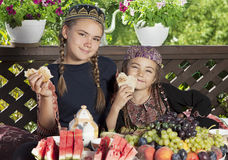 Two little girls have breakfast at chaikhana Stock Images