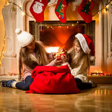 Two little girls having a fight of present on Christmas Stock Image