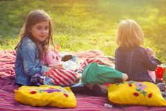 Two little girls having picnic in the backyard Stock Photos