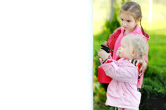 Two little girls helping in a garden Royalty Free Stock Photography