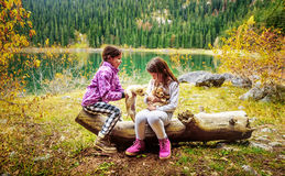 Two little girls hiking on Black Lake ( Crno jezero),Durmitor, M Stock Photo