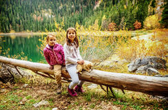 Two little girls hiking on Black Lake ( Crno jezero),Durmitor, M Stock Photos