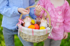 Two little girls holding a basket of Easter eggs Royalty Free Stock Images
