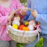 Two little girls holding a basket of Easter eggs Royalty Free Stock Photos