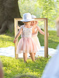Two little girls holding a painting frame Royalty Free Stock Photos