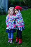 Two little girls huges outdoor Royalty Free Stock Photos