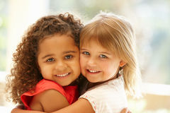 Two little girls hugging Royalty Free Stock Photography