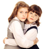 Two little girls hugging. Isolated Royalty Free Stock Photos