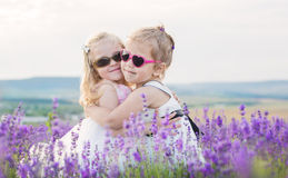 Two little girls hugging Royalty Free Stock Photos