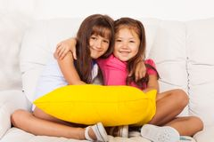 Two little girls hugging with pillows Royalty Free Stock Image