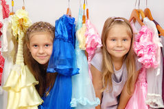Two Little Girls In Shop Of Dresses Stock Photo
