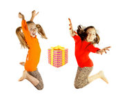 Two little girls jumping Stock Photo