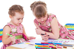 Two little girls in kindergarten Stock Image