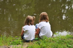 Two Little Girls by the lake Royalty Free Stock Photo