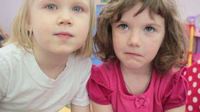 Two little girls looking at the camera stock video footage