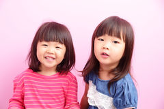 Two little girls looking front Stock Photos