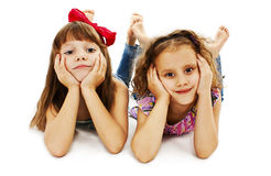 Two little girls are lying on the floor Royalty Free Stock Images