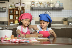Two Little Girls Make Pizza Stock Image