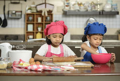 Two Little Girls Make Pizza Royalty Free Stock Image