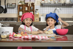 Two Little Girls Make Pizza Royalty Free Stock Photo